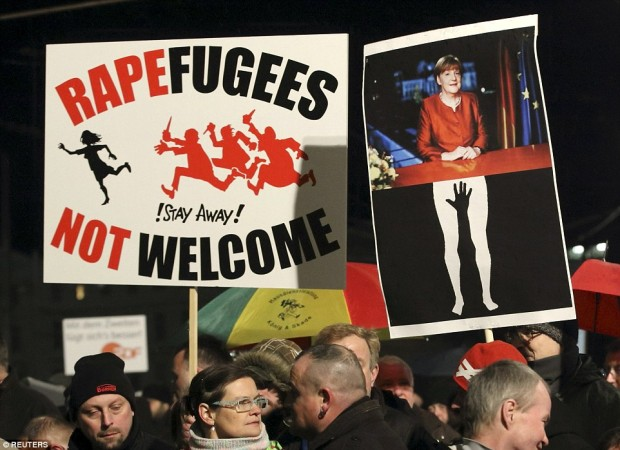merkel-and-rapefugee-signs-620x450